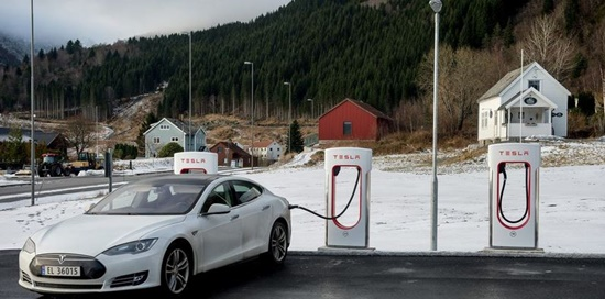 Image of a Tesla electrical car being charged in Norway
